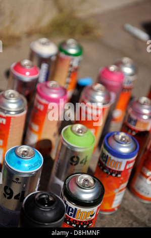 Spray paint cans used for graffiti painting - Stock Photo