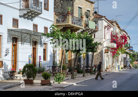 Traditional old houses on the main street of Kardamyli village in the Outer Mani, Messinia, Peloponnese, Greece. - Stock Photo