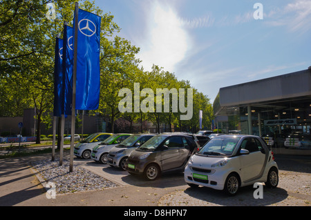 Smart micro compact cars on display at a Mercedes Benz car dealer - Heilbronn Germany - Stock Photo