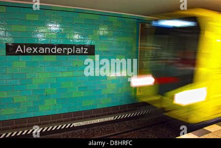 Metro train arrives at Berlin Alexanderplatz UBahn Station - Stock Photo