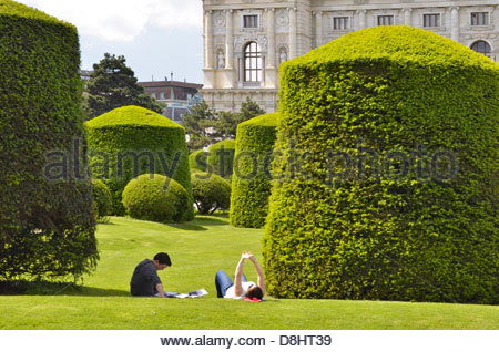 Young people relaxing in park, Maria-Theresien-Platz in Vienna Austria - Stock Photo