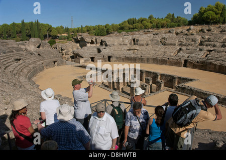 Roman ruins of Italica -amphitheater and tourists, Santiponce, Seville-province, Region of Andalusia, Spain, Europe - Stock Photo