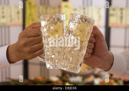 Two People Toasting with Whisky and Soda at Izakaya - Stock Photo