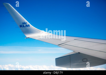 Window view from KLM jet flying over cloud - Stock Photo