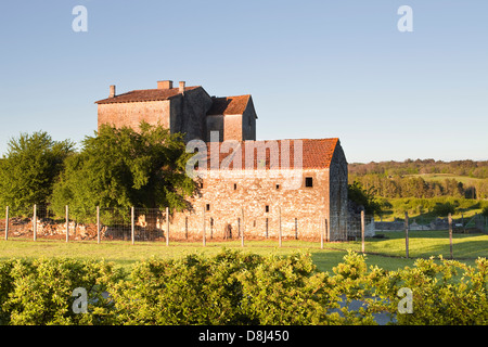 The old priory in Sainte Croix de Beaumont. - Stock Photo