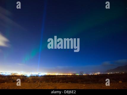 Europe, Iceland, Reykjavik, northern lights aurora borealis and light from the Yoko Ono Imagine Peace Tower - Stock Photo