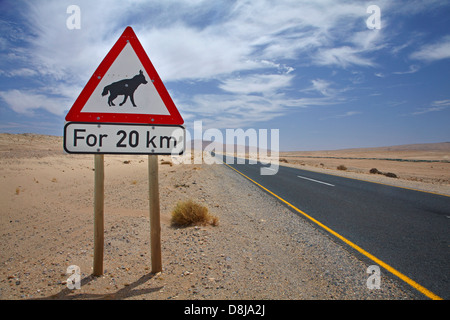 Brown Hyena road warning sign on B4 road between Aus and Luderitz, Southern Namibia, Africa - Stock Photo