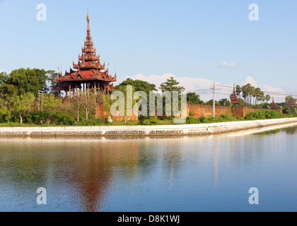A bastion at of the wall surrounding Mandalay Palace, surrounded by a moat in Mandalay, Burma - Stock Photo