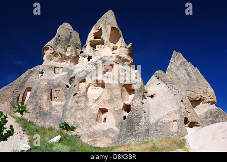 Cappadocia landscape with vulcanic rocks and houses carved in this rock. Goreme, Anatolia in Turkey. - Stock Photo