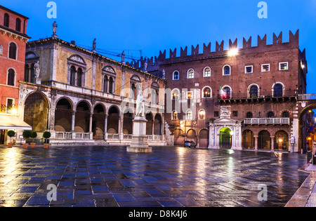 Piazza dei Signori is the civic and political heart of Verona, with the statue of Dante in the middle of square. - Stock Photo