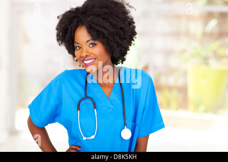 pretty female african medical worker in office - Stock Photo