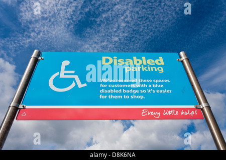 Sign for disabled parking zone in a supermarket car park. - Stock Photo