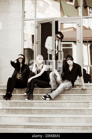 Young people relaxing on the steps - Stock Photo