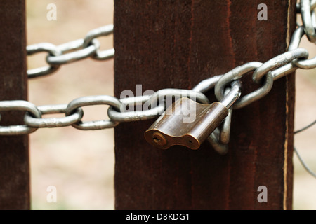 old lock on the wood door of color brown - Stock Photo