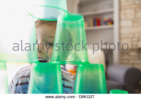 Smiling boy playing with plastic cups - Stock Photo