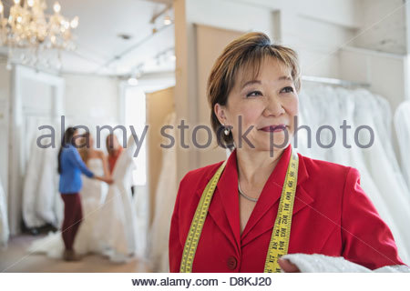 Small business owner working in bridal store - Stock Photo