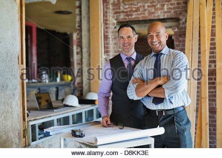 Portrait of male architects at construction site - Stock Photo