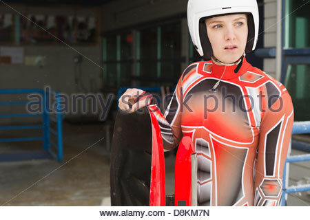 Female luge athlete preparing for race - Stock Photo