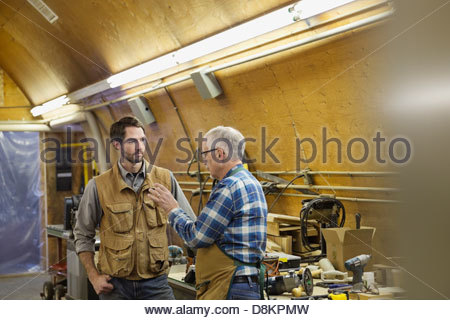 Woodworkers having a conversation at workshop - Stock Photo