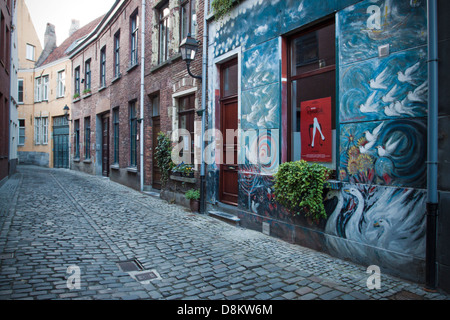 A beautiful drawing on front of a typical house Belgian in Patershol neighborhood in Ghent - Stock Photo