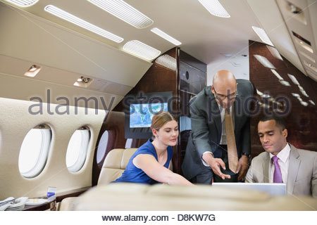 Business people working in private jet - Stock Photo
