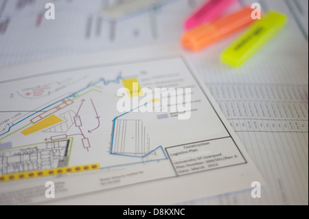 Construction plans at a building site. - Stock Photo