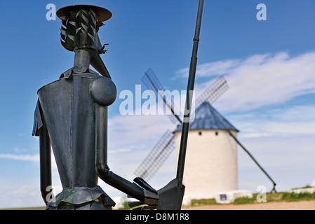 Spain, Castilla-La Mancha: Windmill  and statue of Don Quijote in Campo de Criptana - Stock Photo