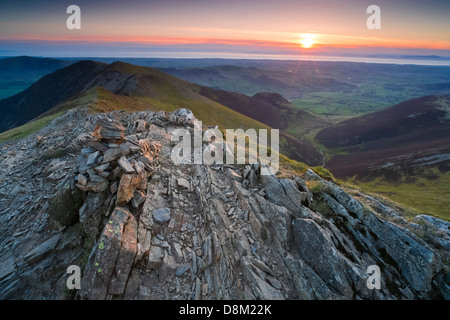 Looking towards Whiteside and Hope Gill from the summit of Hopegill Head at sunset in the Lake District. - Stock Photo
