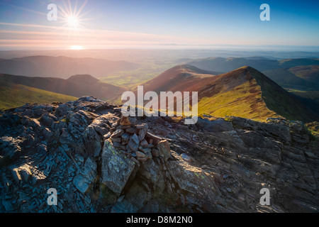 Looking towards Ladyside Pike and Hope Gill from the summit of Hopegill Head at sunset in the Lake District - Stock Photo