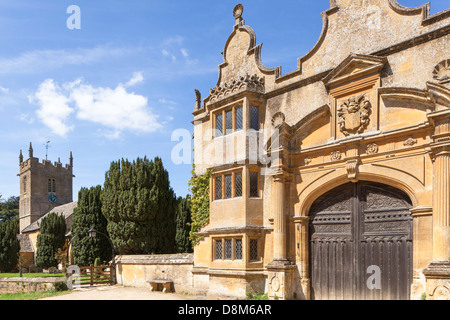 St Peter's Church and the entrance to Stanway House, in the Cotswold village of Stanway, Gloucestershire, England, - Stock Photo
