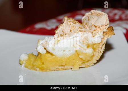 Slice of home made lemon meringue pie on white plate - Stock Photo