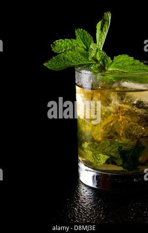 close up of a mint julep served on the rocks and garnished with fresh green mint on top, kentucky derby drink - Stock Photo