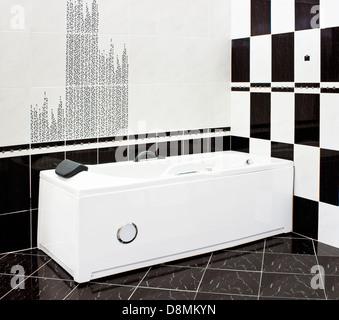 Modern tiled bathroom in black and white - Stock Photo