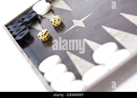 Backgammon dice and pieces isolated on white - Stock Photo