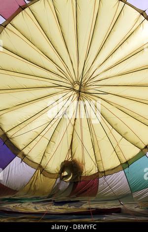 prepairing of a hot-air balloon ride - Stock Photo
