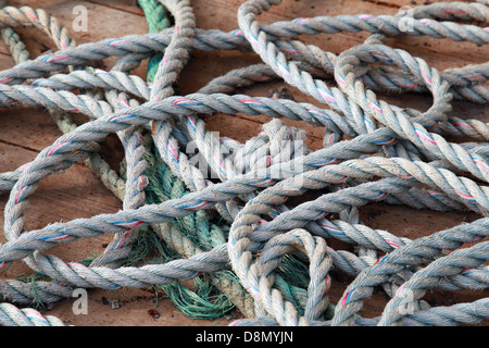 Nautical rope lies on the ships deck - Stock Photo