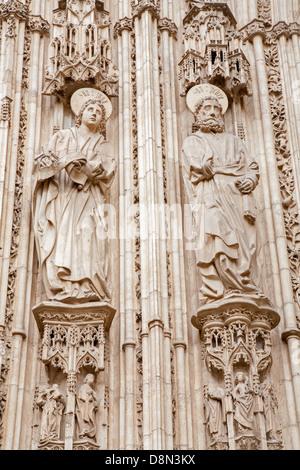 TOLEDO - MARCH 8: Apostle Peter and John from south gothic portal of Cathedral Primada Santa Maria de Toledo - Stock Photo