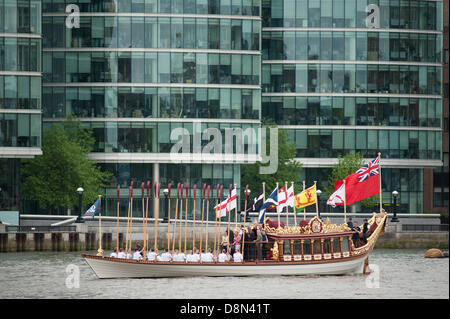 London, UK. 1st June 2013. Teams are accompanied by the Royal Rowing Barge Gloriana moving upstream to HMS Belfast - Stock Photo