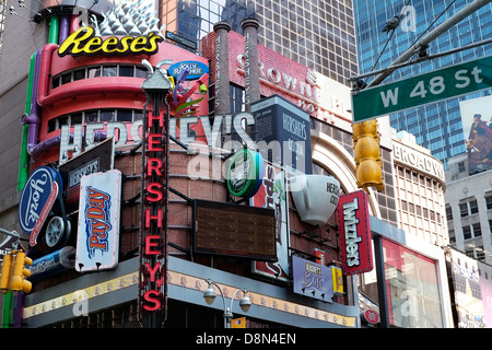 Corporate billboards on the side of a building in Times Square, New York City. - Stock Photo
