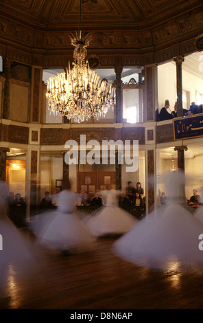 Dervishes perform the Sema ceremony at the Galata Mevlevihanesi, Museum of Court Literature in Beyoglu district - Stock Photo