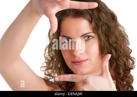 Woman framing a picture with her hands, isolated in white - Stock Photo