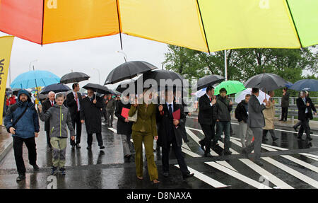 Invited gests and citizens of the city of Zittau walk to the opening of the new German-Polish frontier bridge on - Stock Photo