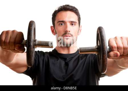 Personal Trainer doing front dumbell raises for training his deltoids, isolated in white - Stock Photo