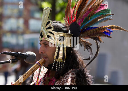 Manchester, UK. 1st June 2013. Sergio Fistely (MR) a street entertainer in Aztec Indian Native American costume - Stock Photo