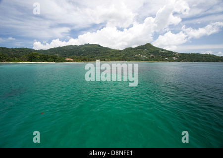 Turquoise sea off the coast of Mahe, Seychelles. - Stock Photo