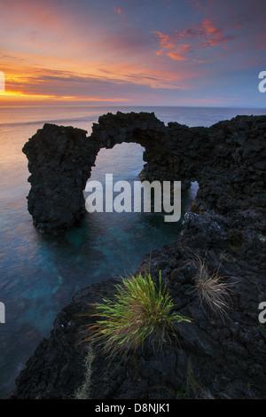 Natural arch of Fajã da Ribeira da Areia at sunset - São Jorge island - Azores - Stock Photo