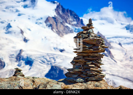 Big hand-made stone tower in Alps. - Stock Photo
