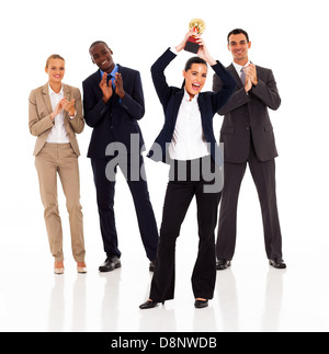 business team applauding when businesswoman winning a trophy - Stock Photo