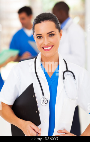 pretty female medical worker in front of colleagues - Stock Photo