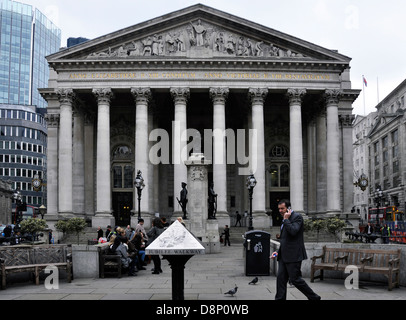 The Royal Exchange in London, with people sitting outside and a businessman passing by on his mobile phone. England, - Stock Photo